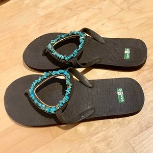 Sanuk flip flops with turquoise accents